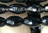 CAA2498 15.5 inches 6*9mm faceted rice black agate beads wholesale