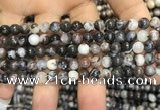 CAA3591 15.5 inches 4mm round black zebra agate beads wholesale