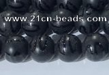 CAA3660 15.5 inches 6mm round matte & carved black agate beads