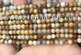 CAA4933 15.5 inches 4mm round yellow crazy lace agate beads wholesale