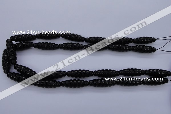 CAG1695 15.5 inches 10*30mm carved rice black agate beads
