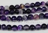 CAG2094 15.5 inches 6mm faceted round purple line agate beads