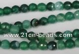 CAG2112 15.5 inches 6mm faceted round green line agate beads