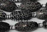 CAG2295 15.5 inches 13*25mm faceted rice fire crackle agate beads