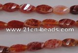 CAG4180 15.5 inches 6*12mm faceted & twisted rice natural fire agate beads