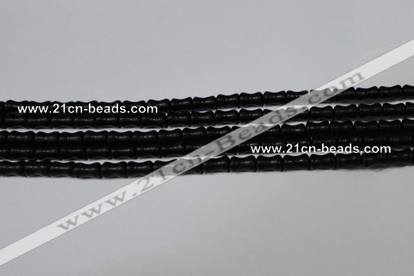 CAG6038 15.5 inches 4*8mm bone matte black agate beads