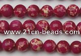 CDE2033 15.5 inches 4mm round dyed sea sediment jasper beads