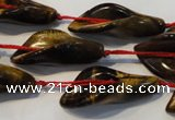 CFG566 15.5 inches 14*28mm carved trumpet flower yellow tiger eye beads
