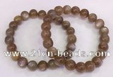 CGB4549 7.5 inches 9mm - 10mm round sunstone beaded bracelets