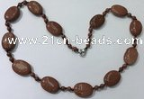 CGN201 22 inches 6mm round & 18*25mm oval goldstone necklaces