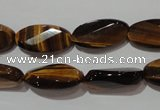 CTE1098 15.5 inches 10*20mm twisted & faceted oval yellow tiger eye beads