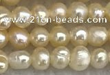 FWP15 14.5 inches 3mm - 3.5mm potato pink freshwater pearl strands