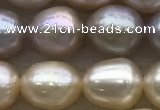 FWP194 15 inches 7mm - 8mm rice light purple freshwater pearl strands