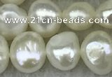 FWP241 15 inches 6mm - 7mm baroque white freshwater pearl strands