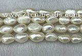 FWP304 15 inches 11mm - 12mm baroque white freshwater pearl strands