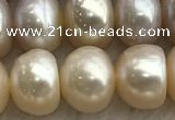 FWP327 15 inches 9mm - 10mm button purple & pink freshwater pearl strands
