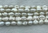 FWP351 15 inches 8mm - 9mm baroque white freshwater pearl strands